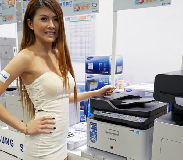 Woman With Laser Printer